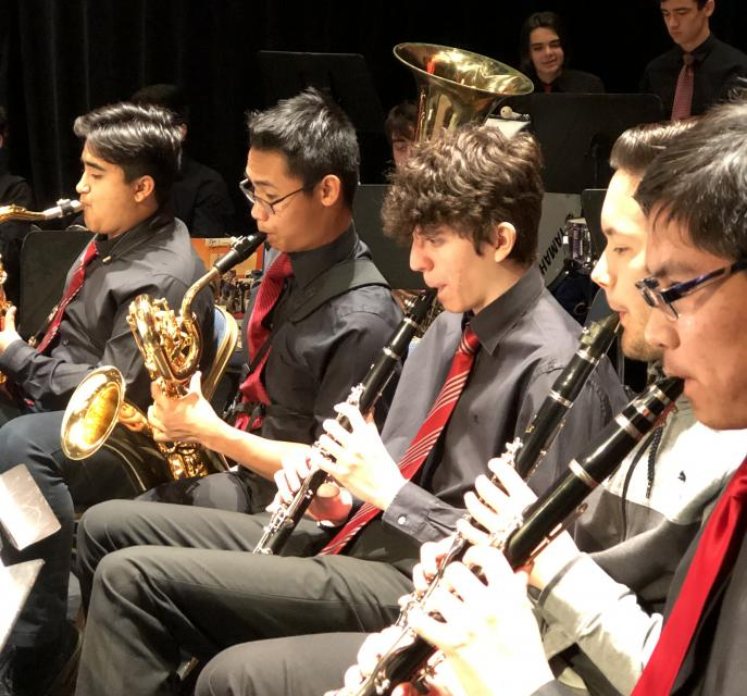 Woodwinds playing at graduation ceremony