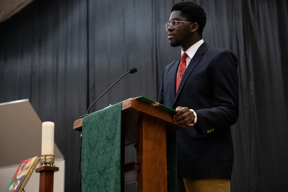Student Obinna Okoye '19 speaks at last year's  Mass for Peace and Justice
