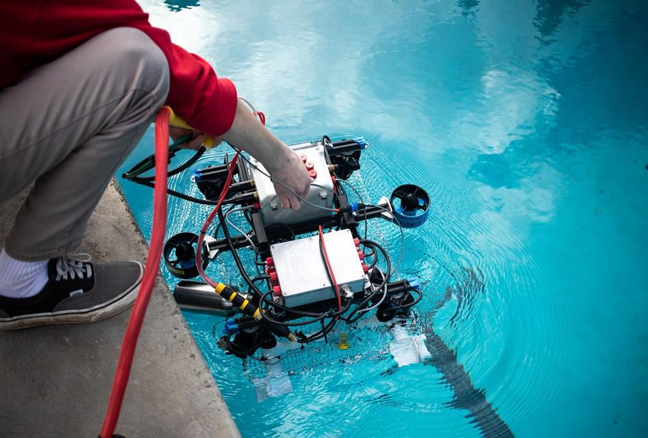 Underwater ROV being dropped into pool