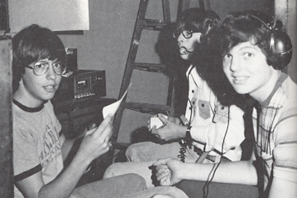3 boys from 1977 Tech crew with headphones and scripts.
