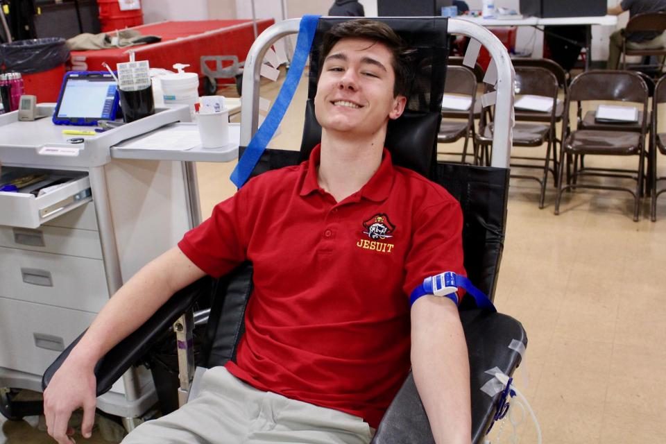 Student Carter Wink '20 participates in Jesuit's annual Blood Drive.