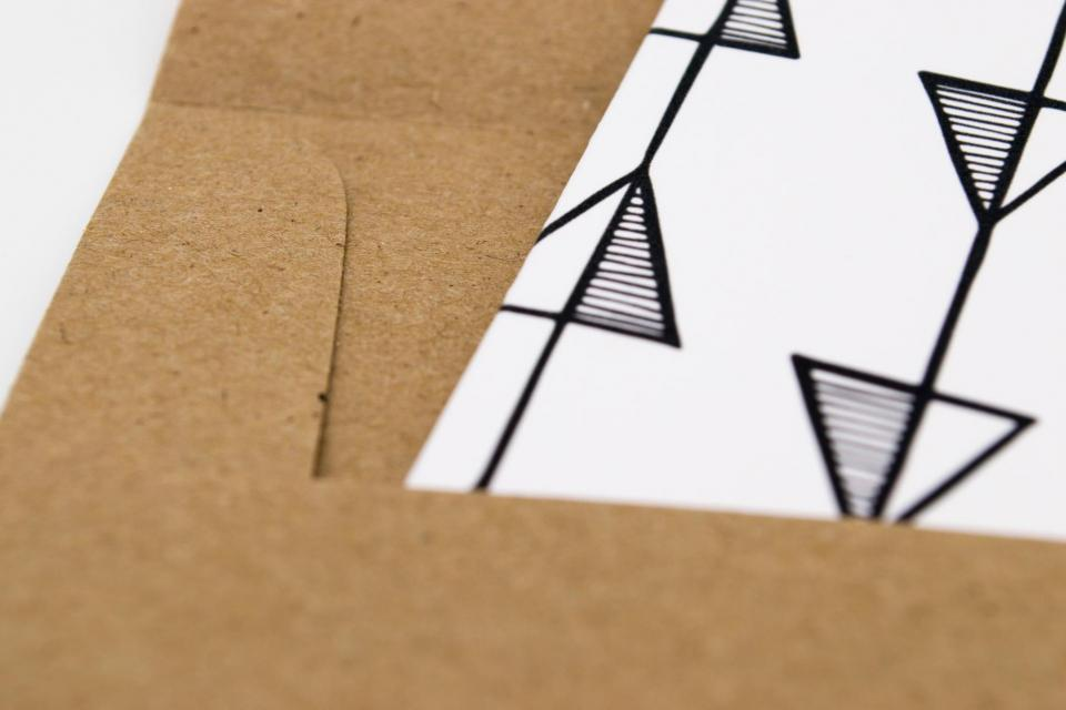 Image of card sliding into envelope
