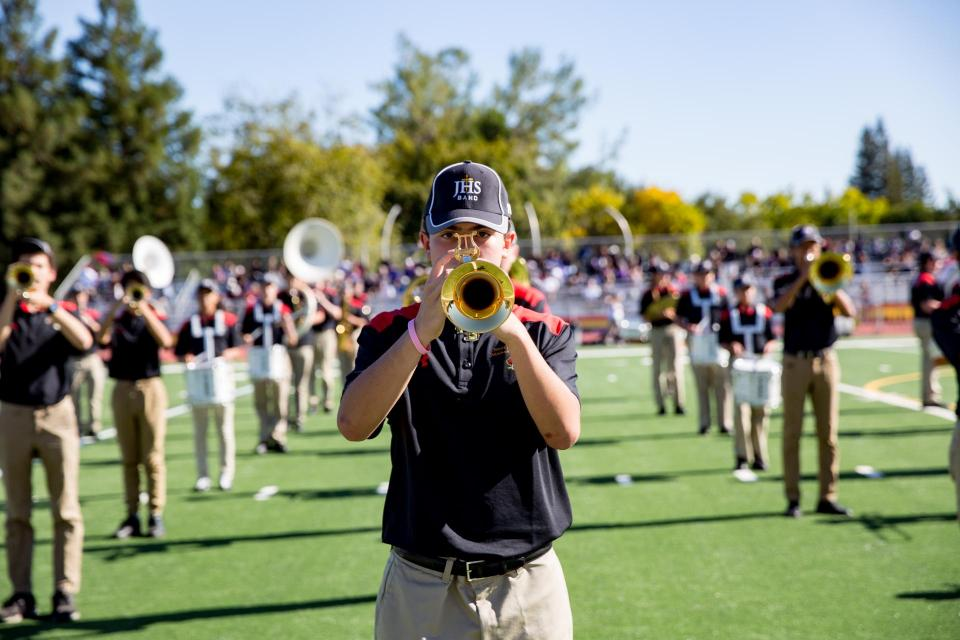 Close-up of trumpet player in formation on field