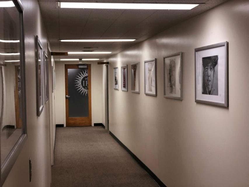 Hallway with framed prints along one side
