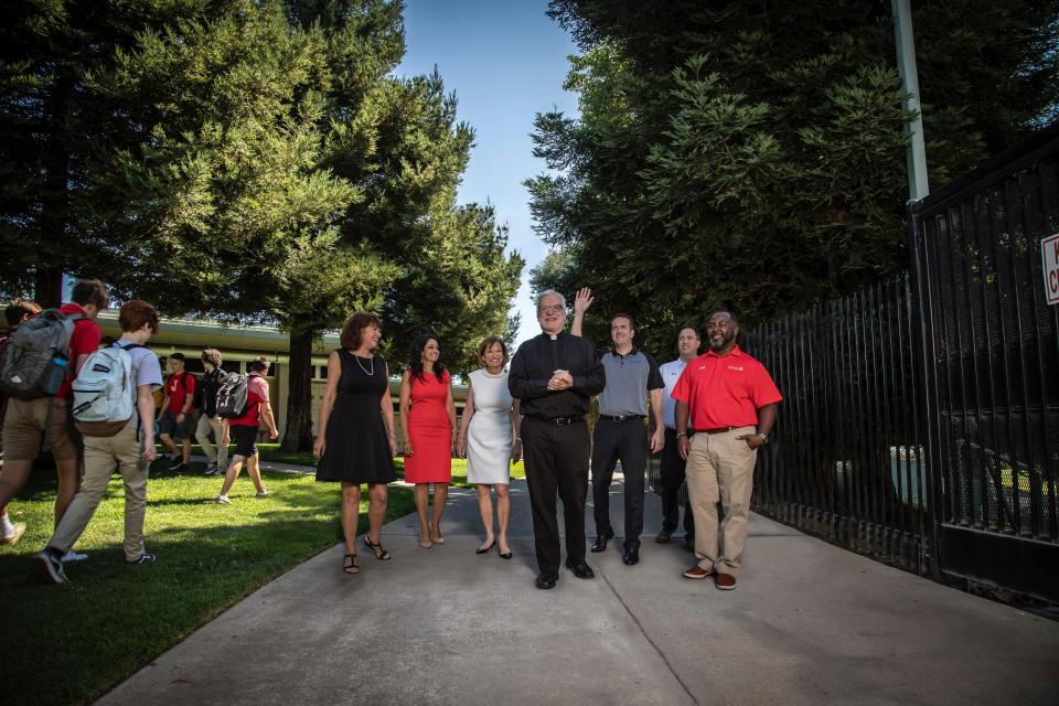 Jesuit leadership team walk campus among students at lunch