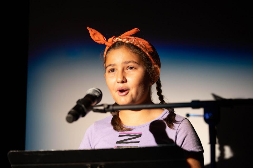 Image of girl at microphone.