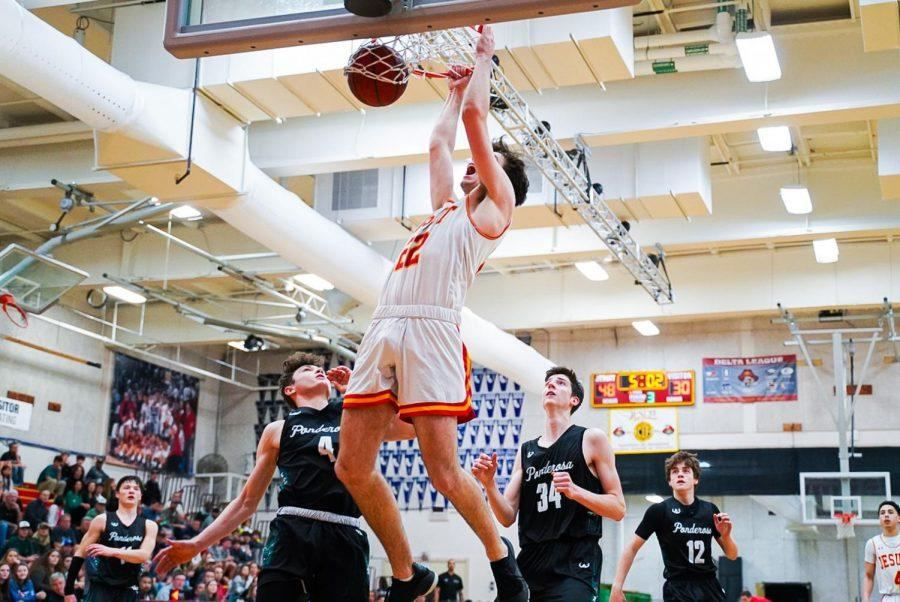 Big man Jack Andre '20 dunks in Jesuit's home basketball game against Ponderosa High School on Friday, Feb. 21.