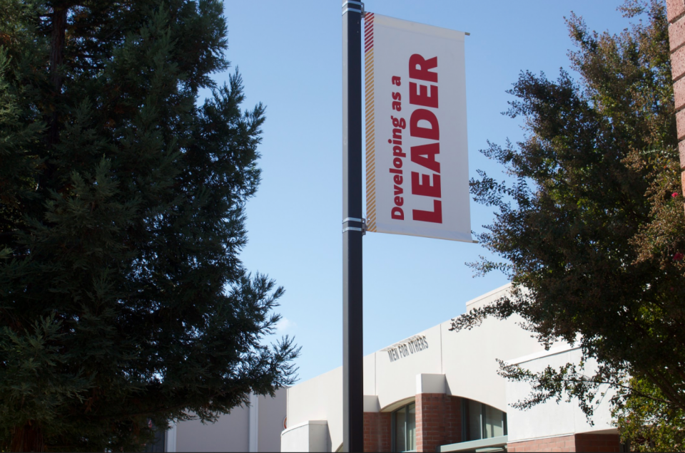 "Sign on campus light pole that reads ""Developing as a Leader"""