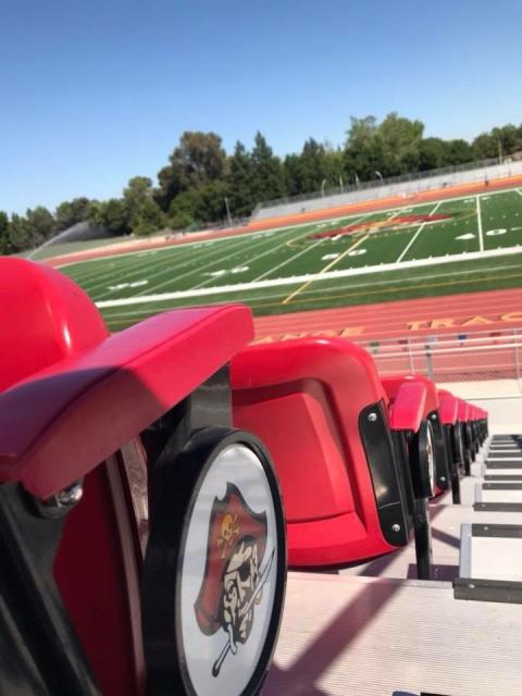 Close up of red stadium seats