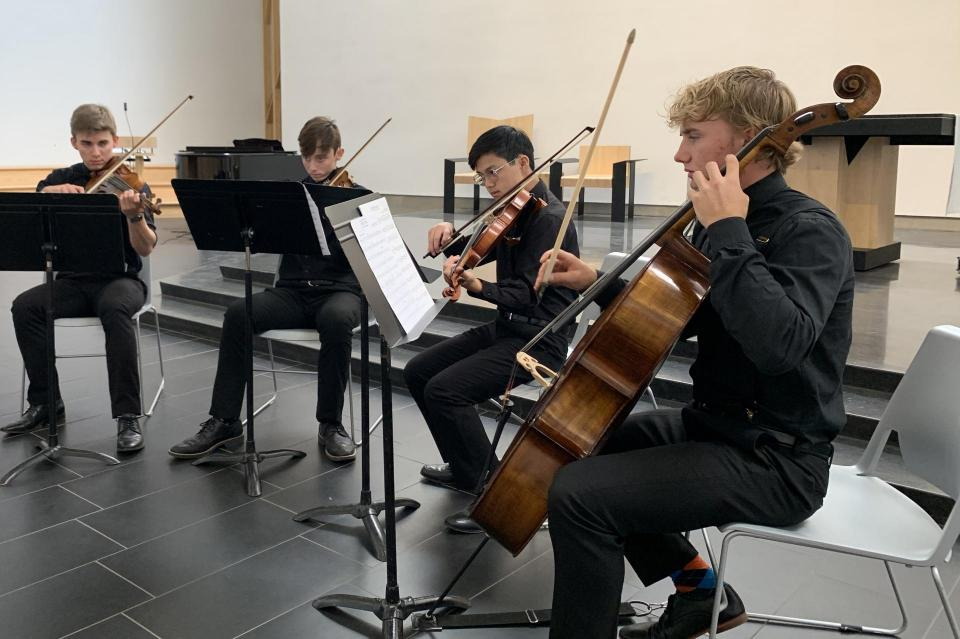 Small group of strings playing in the chapel during Open House