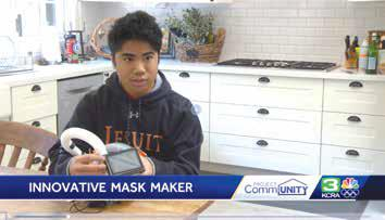 Image of student holding his modified snorkel mask